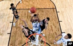North Carolina's Isaiah Hicks (4) takes a shot during finals of the Final Four NCAA college basketball tournament against Gonzaga in April. North Carolina won. AP Photo/Chris Steppig, Pool)