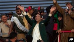 Bilawal Bhutto Zardari, center, chairman of Pakistan main opposition party 'Pakistan Peoples Party' waves to party supporters as he leave after addressing a rally in Karachi, Pakistan, Saturday, Oct. 18, 2014.