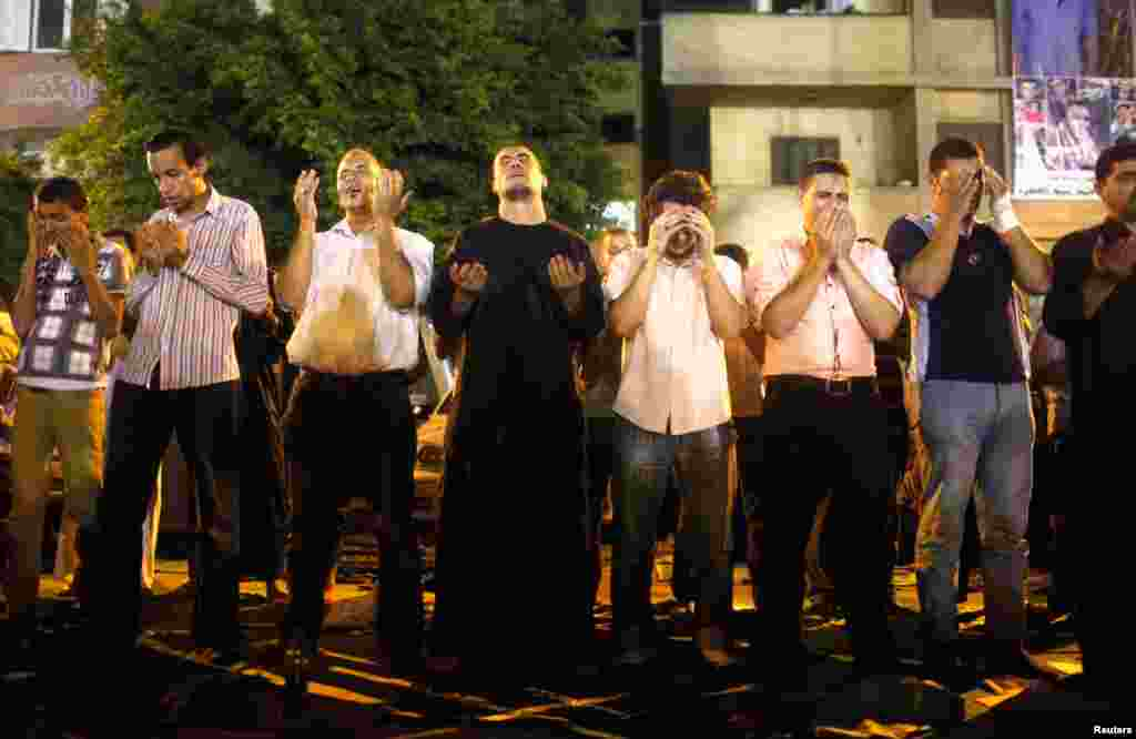 People perform Ramadan night prayers in Cairo, celebrating Lailat al-Qadr (the Night of Power), August 4, 2013.