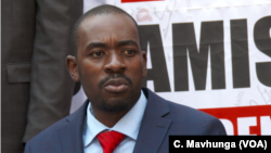 Nelson Chamisa, the leader of the Movement for Democratic Change Alliance, listens as a journalist asks a question, Aug. 4, 2108 in Harare, Zimbabwe.