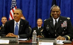 FILE - U.S. President Barack Obama sits next to Commander of Central Command Gen. Lloyd Austin III during a briefing from top military leaders while at U.S. Central Command at MacDill Air Force Base in Tampa, Florida, September 17, 2014