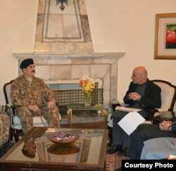 FILE - This picture released by Pakistan's army shows General Raheel Sharif meeting with Afghan President Ashraf Ghani, Dec. 27, 2015.