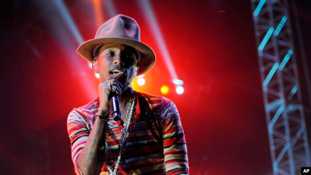 Pharrell Williams performs at the 2014 Coachella Music and Arts Festival on Saturday, April 12, 2014, in Indio, Calif.
