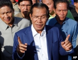 FILE - Cambodian Prime Minister Hun Sen gestures while speaking in Phnom Penh, Cambodia, Aug. 1, 2018.