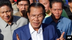 Cambodian Prime Minister Hun Sen gestures while speaking in Phnom Penh, Cambodia, on August 1. Hun Sen has been criticized for silencing opposition voices.
