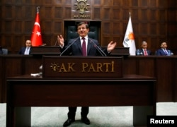 FILE - Turkish Prime Minister Ahmet Davutoglu addresses lawmakers from his ruling AK Party (AKP) at the Turkish parliament in Ankara January 6, 2015.