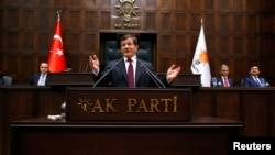 Turkish Prime Minister Ahmet Davutoglu addresses lawmakers from his ruling AK Party (AKP) at the Turkish parliament in Ankara January 6, 2015.