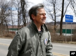"FILE - In this March 28, 2015 photo, Joe Sestak, a candidate seeking the Democratic Party nomination for the US Senate, passes a sign for the border between Pennsylvania and Ohio as he completes his ""Walking In Other Pennsylvanian's Shoes,"" a walking tour across the state."