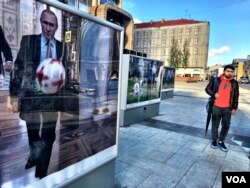 An image of Vladimir Putin playing soccer in the Kremlin adorns a downtown Moscow street. Securing mega-sporting events like the World Cup and the 2014 Winter Olympics have helped the Russian president craft his image as the leader of a country rising on