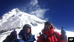 Yuichiro Miura, right, and his son, Gota pose at their South Col camp at 8,000 meters before their departure for Camp 5 during their attempt to scale the summit of Mount Everest, May 22, 2013. (AP Photo/Miura Dolphins Co. Ltd.)