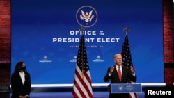 U.S. President-elect Joe Biden and Vice President-elect Senator Kamala Harris answer questions from reporters following an online meeting with members of the National Governors Association (NGA) executive committee in Wilmington, Delaware, U.S., November