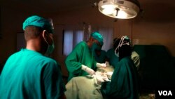FILE - Doctors are seen operating on a cancer patient in a hospital. (Photo - Rael Ombuor/VOA)