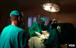 FILE - Doctors are seen operating on a cancer patient at a Nairobi hospital. The Kenya Cancer Association says it is getting reports of three deaths a week — a 50 percent increase compared to this time last year. (R. Ombuor/VOA)