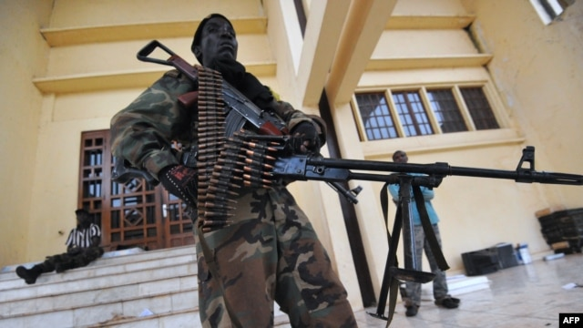 A Seleka coalition rebel stands guard on March 25, 2013 inside the presidential palace compound in Bangui.