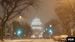 The illuminated dome of the US Capitol could be seen through the wind-blown snow in Northeast Washington (P. Datcher/VOA)