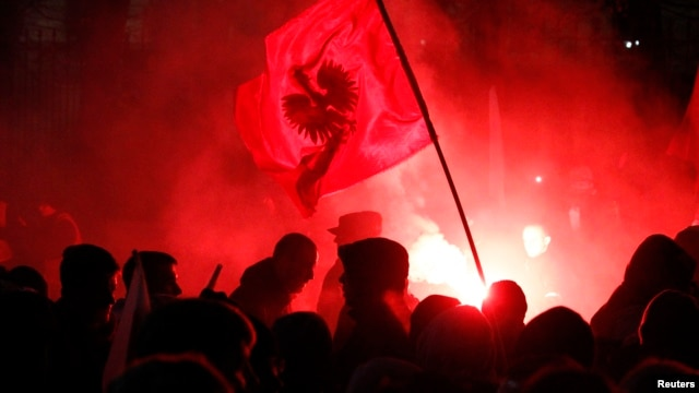 Far-right protesters light flares in front of the building of Russian embassy during the annual far-right march, which coincides with Poland's national Independence Day, in Warsaw, Nov. 11, 2013.