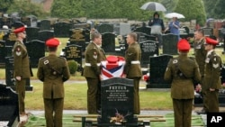 British soldiers from the Light Dragoons lay to rest their fallen colleague, Lance Corporal Nigel Moffett, during a burial service in Belfast (file photo).