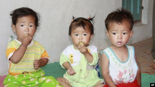 Children eat bread at a nursery in Myongchon County, North Hamgyong province in this handout picture (File)