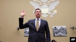 Direktur Biro Penyelidik Federal (FBI), James Comey memberikan kesaksian di depan Komisi Kongres AS, Kamis (7/7).
