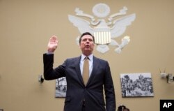 FILE - FBI Director James Comey is sworn in on Capitol Hill in Washington, July 7, 2016.