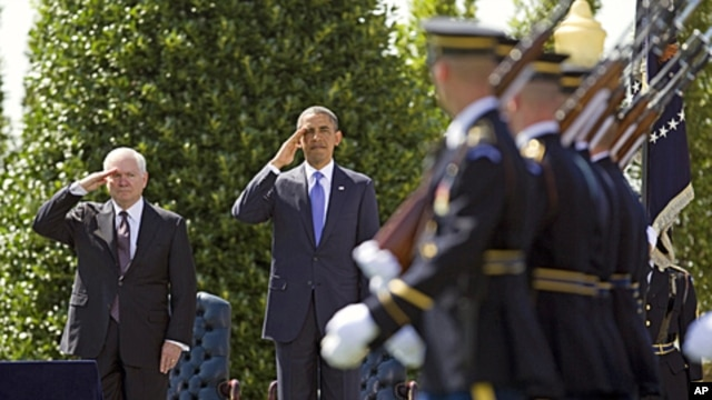 Outgoing Defense Secretary Robert Gates and President Barack Obama salute during a farewell ceremony for Gates at the Pentagon, June 30, 2011.