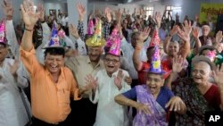 FILE - Elderly Indians participate in celebrations to mark International Day of Older Persons at an old age home in Ahmadabad, India, Oct. 1, 2013.