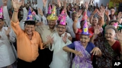 Global Aging: Elderly Indians participate in celebrations to mark International Day of Older Persons at an old age home in Ahmadabad, India.
