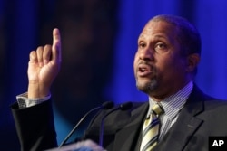 FILE - Author and talk show host Tavis Smiley speaks at Book Expo America in New York.