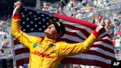 Ryan Hunter-Reay celebrates after winning the 98th running of the Indianapolis 500 IndyCar auto race at the Indianapolis Motor Speedway in Indianapolis, Indiana, May 25, 2014.