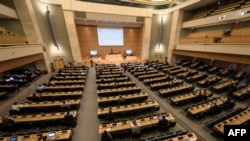 This photograph taken on September 18, 2020, shows a general view on the opening of a meeting of the United Nations Human Rights Council on allegations of torture and other serious violations in Belarus, in Geneva. (Photo by Fabrice COFFRINI/AFP)