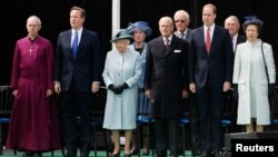 (L-R) The Archbishop of Canterbury Justin Welby, Britain's PM David Cameron, Britain's Queen Elizabeth, Prince Philip, Prince William and Princess Anne attend an event marking the 800th anniversary of Magna Carta in Runymede, June 15, 2015.