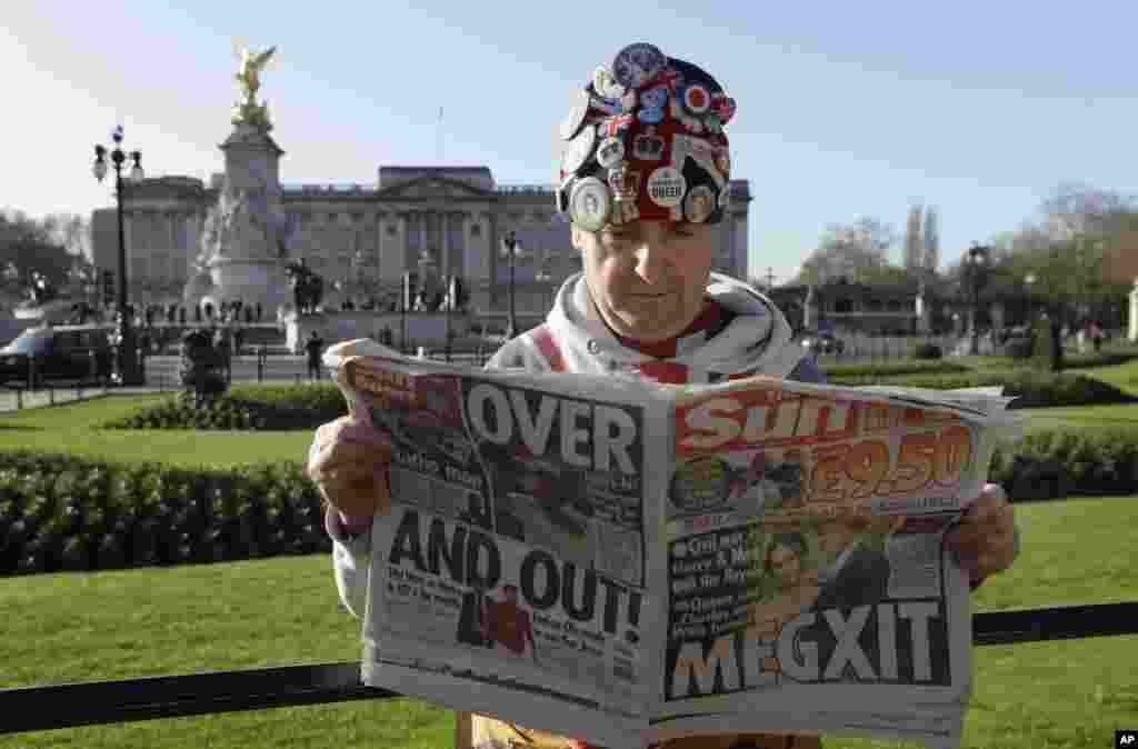 Self-proclaimed royal super-fan John Loughrey reads a tabloid newspaper in London.