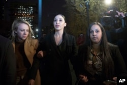 """Emma Coronel, center, the wife of Joaquin Guzman, leaves Brooklyn Federal Courthouse after opening statements in the trial of the Mexican drug lord known as """"El Chapo,"""" Nov. 13, 2018, in New York."""