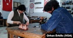 Australian tourists learning to become coppersmiths in Gaziantep, southeastern Turkey