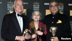 (L-R) James Ivory, Ruth Prawer Jhabvala and Ismail Merchant, who together form Merchant Ivory Productions, receive a British Academy film fellowship at a ceremony in central London, Feb. 24, 2002.