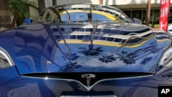 FILE - A Tesla Model S on display in downtown Los Angeles, Oct. 24, 2016. Tesla Motors fired hundreds of workers after completing its annual performance reviews, even though the electric automaker is trying to ramp up production to meet the demand for its new Model 3 sedan.