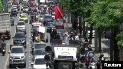 Thai drivers take to streets to protest government's handling of covid crisis