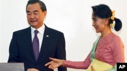 Leader of the National League for Democracy Party (NLD) and Burma's new Foreign Minister Aung San Suu Kyi, right, and Chinese Foreign Minister Wang Yi, joint press conference, Naypyitaw, April 5, 2016. Foreign minister is one of the posts that the Nobel Peace Prize-winner holds.