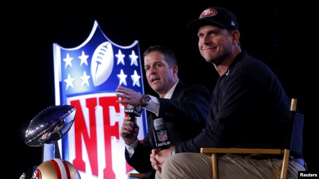 San Francisco 49ers head coach Jim Harbaugh (R) and his brother, Baltimore Ravens head coach John Harbaugh, speak during their joint press conference ahead of the NFL's Super Bowl XLVII in New Orleans, Louisiana, Feb. 1, 2013