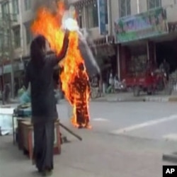 Still image of Tibetan Palden Choetso's self-immolatation.