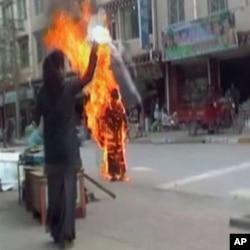 Still image of Tibetan Palden Choetso's self-immolatation.