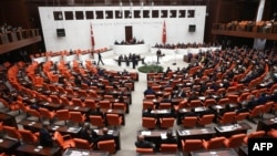 FILE - Turkish MPs and ministers attend a debate as the parliament reconvenes after a summer recess in Ankara, Oct. 1, 2015.