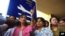 Mu Sochua, an opposition party lawmaker, at Phnom Penh Municipal Airport on Monday.