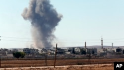 Smoke rises after an airstrike in Kobani, Syria.