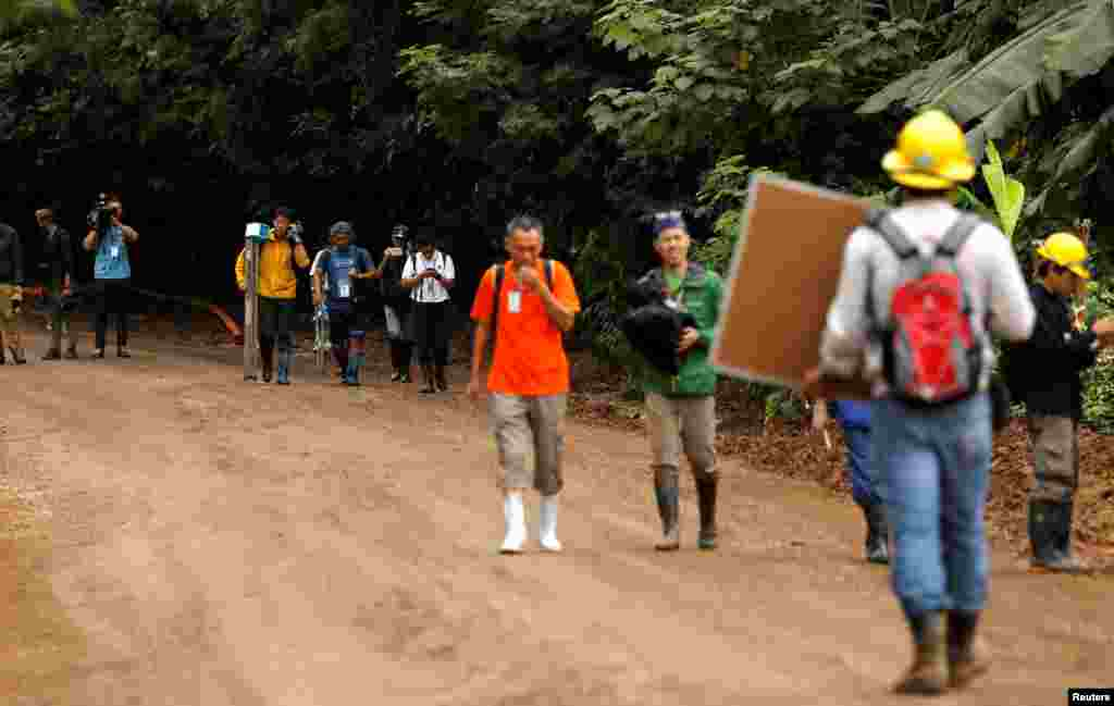 Journalists leave the site of the Tham Luang cave complex after Thailand's government instructed members of the media to move out urgently, in the northern province of Chiang Rai, July 8, 2018.