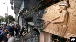 Egyptian investigators check the scene of a nightclub attack in Cairo, Egypt, Dec. 4, 2015.