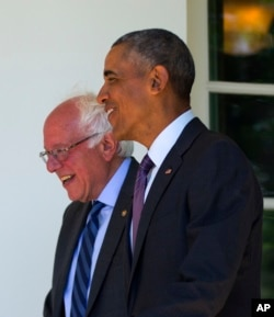 President Barack Obama walks with Democratic presidential candidate Sen. Bernie Sanders of Vermont down the Colonnade of the White House in Washington, June 9, 2016.