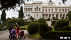 Women push strollers in the park of Livadia Palace where U.S. President Franklin D. Roosevelt, British Prime Minister Winston Churchill and Soviet leader Joseph Stalin held the Yalta Conference in Yalta, Crimea, March 11, 2014.