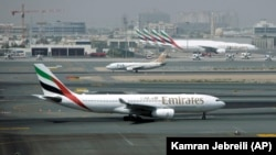 In this Tuesday April 20, 2010 file photo, an Emirates airline passenger jet taxis on the tarmac at Dubai International airport in Dubai, United Arab Emirates. . (AP Photo/Kamran Jebreili, File)