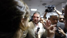 Osama Morsi, son of Egypt's ousted President Mohamed Morsi, speaks to the media after a news conference in Cairo Jul. 22, 2013.
